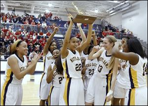 Jayda Worthy holds up the Division I regional championship trophy after Notre Dame defeated Wadsworth. The Eagles (25-4), who lost in the state semifinals, won the Three Rivers Athletic Conference title.