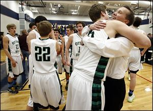 Lucas Janowicz hugs Ottawa Hills coach John Lindsay after defeating Toledo Christian in the Division IV district final.