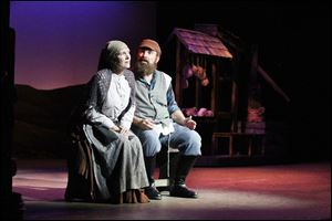 Robert Summers II and Jennie Hollander as Tevye and Golde in 'Fiddler on the Roof,' which comes to Toledo next week. The original Broadway production opened in September, 1964, and closed in July, 1972, after 3,242 performances.