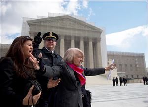 Edith Windsor of New York, arms outstretched, greets a sea of supporters outside the Supreme Court, which heard arguments on the Defense of Marriage Act.