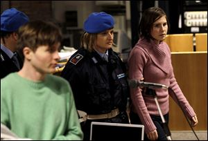 Amanda Knox, right, walks past Raffaele Sollecito, as she arrives after a break to attend a hearing in her appeals trial, at Perugia's courthouse, Italy, in December, 2010.