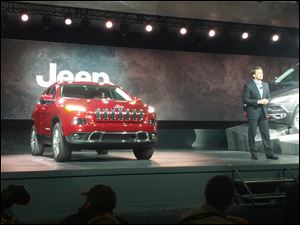 Mike Manley, Jeep brand Chief Executive, shows off the new 2014 Jeep Cherokee at the New York Auto Show.