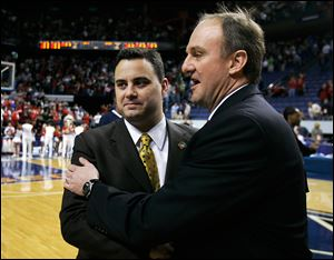 Sean Miller, left, and Ohio State coach Thad Matta meet before a 2007 NCAA tournament game when Miller coached at Xavier. Miller was an assistant for Matta when he coached the Musketeers. The Buckeyes got past Xavier and went onto the NCAA final.