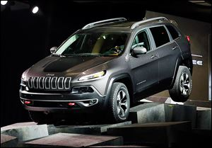 The 2014 Jeep Cherokee Trailhawk drives over obstacles as it is introduced Wednesday at the New York International Auto Show.