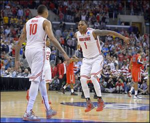 Ohio State's LaQuinton Ross, left, and Deshaun Thomas celebrate after Ross' late 3-pointer sealed a dramatic win against Arizona.