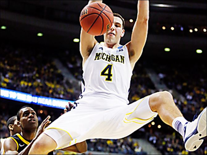 Michigan forward Mitch McGary  Michigan forward Mitch McGary posted 21 points and 14 rebounds last weekend in a 78-53 win against No. 5 seed Virginia Commonwealth.