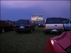 Owners of the Field of Dreams Drive-In in Liberty Center, Ohio, took out loans to invest in digital projection equipment.