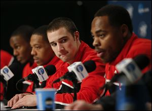 Ohio State's Aaron Craft, center, listens to Deshaun Thomas, right, during a news conference Friday in Los Angeles. Ohio State plays Wichita State in the West Regional finals of the NCAA college basketball tournament tonight.