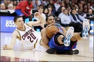 Philadelphia 76ers' Evan Turner, right, looks for help after grabbing a loose ball under pressure from the Cavaliers' Chris Quinn. Turner scored 23 points.