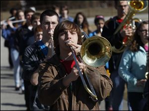 A.J. Metzger plays the trombone during the Northview High School Marching Band performance.