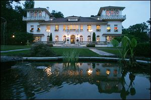 The 1926 24,000 square-foot 'Italian castle' that sits on five acres in Englewood and Englewood Cliffs, N.J., took its current owners two years to renovate the property. The estate includes a pool, gym, home theater, seven-car garage, and a lake home to waterfowl.