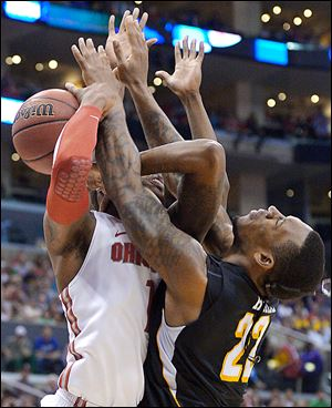 Ohio State forward Deshaun Thomas, left, and Wichita State forward Carl Hall get tangled up.