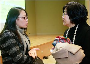 Qiuying Zhao, left, speaks with Margaret Wong, an immigration attorney and civic leader from Cleveland during the Women of the World Symposium.
