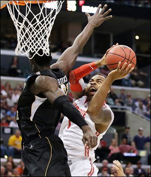 Wichita State center Ehimen Orukpe defends Ohio State forward Deshaun Thomas in the first half when the Buckeyes shot just 24 percent. OSU fell behind by 20 points in the second half before staging a furious rally that fell short. Ohio State finishes 29-8.