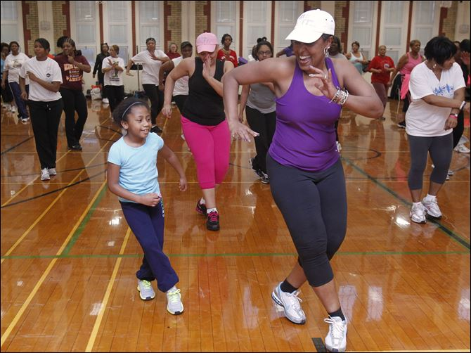 HUBS Heather Hayward Heather Hayward, 9, works out with instructor Angela Steward during Fabulously Fit at Scott High long after the last bell had rung on a Monday evening.