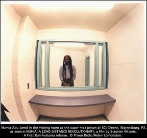 Mumia Abu-Jamal in the visiting room at the super max prison at SCI Greene, Waynesburg, Pa., as seen in the documentary 'Long Distance Revolutionary: A Journey with Mumia Abu-Jamal' a film by Stephen Vittoria.