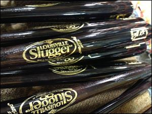 Louisville Slugger is rolling out a new logo for the first time in 33 years on a new bat that company officials say is designed to be the hardest wooden bat ever produced.