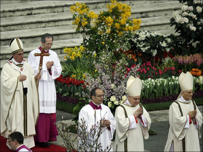 Vatican Pope Easter Pope Francis, holding the pastoral staff, celebrates the Easter mass in St. Peter's Square at the Vatican.