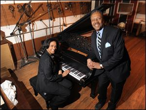 Robin R. Terry, left, chairman of the Board of Trustees of Motown Museum, and Interim Motown Museum CEO Allen Rawls pose for a photo with the prized 1877 Steinway grand piano.