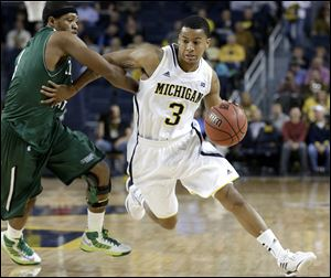 Michigan guard Trey Burke, shown during this regular season game, was selected to the AP All-America team today.