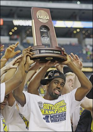 Tim Hardaway, Jr., and his Michigan teammates secured the school's first trip to the Final Four in 20 years on Sunday.