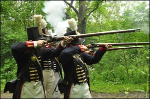 Re-enactors from Fort Meigs will be dressed in period uniforms to perform a musket-firing demonstration Saturday at the Maumee Branch Library and talk about the life of a War of 1812 soldier.