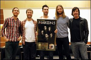 Members of Maroon 5, from left, Jesse Carmichael, Mickey Madden, Adam Levine, James Valentine and Matt Flynn, pose for photos. The Grammy-winning band announced Monday that they will headline the 2013 Honda Civic Tour, which kicks off Aug. 1 in St. Louis.