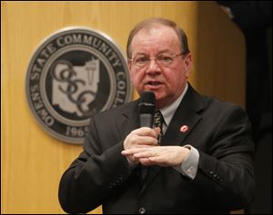 Mike Bower, President of Owens Community College, speaks at a forum at the school in 2012. Owens has announced layoffs to cope with projected budget shortfalls.