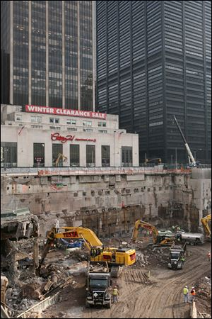 Construction workers and equipment excavate the southeastern corner of the World Trade Center site.