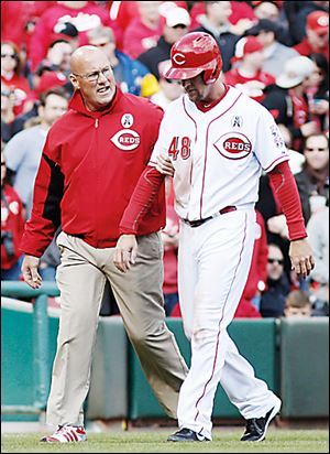 Reds left fielder Ryan Ludwick will require surgery after he dislocated his right shoulder.