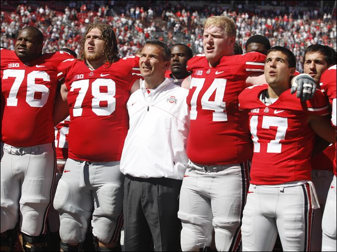 Ohio State Urban Meyer Jack Mewhort Ohio State offensive lineman Jack Mewhort, 74, joins coach Urban Meyer, and teammates, in the singing of 'Carmen Ohio,' following their game against Central Florida last season at Ohio Stadium in Columbus.