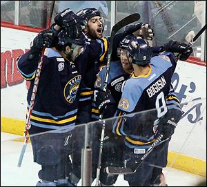 The Walleye celebrate a goal by Randy Rowe in a game at the Huntington Center. Toledo reached the ECHL playoffs for the first time since 2010.