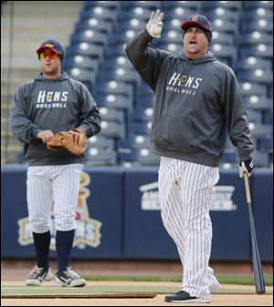 Mud Hens manager Phil Nevin gives instructions while running an infield practice at Fifth Third Field