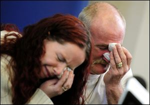 Mick Philpott, right, and wife Mairead react during a news conference in May, 2012, at Derby Conference Centre following a fire at their home  which claimed the lives of six of his children, Derby, England.