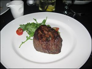 The 10 oz. filet mignon at the London Chop House in Detroit is available to be served with with Bordelaise, Hollandaise or Chimichurri sauce.