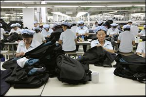 North Korean workers assemble Western-style suits at the South Korean-run ShinWon Corp. garment factory inside the Kaesong industrial complex in Kaesong, North Korea, in September, 2012.