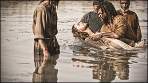 John played by Daniel Percival, right, baptises Jesus played by Diogo Morgaldo in a scene from the 5-part miniseries 'The Bible.'