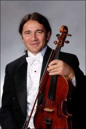 Valentin Ragusitu, violist for the TSO.