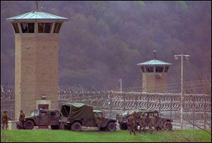 Law officers and National Guard troops assemble outside the Southern Ohio Correctional Facilty April, 1993 as a riot by inmates enters its 10th day.