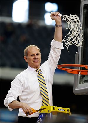 Michigan head coach John Beilein reacts after cutting down the net after a regional final victory against Florida. Beilein hopes to bring UM its first national championship since 1989.
