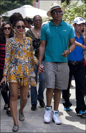 U.S. singer Beyonce and her husband, rapper Jay-Z, hold hands Thursday as they tour Old Havana, Cuba.