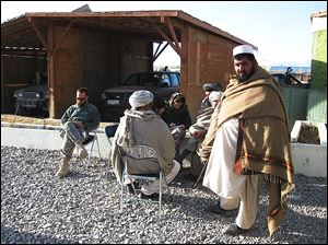 Vanessa Gezari, center, interviews elders in Zormat, Afghanistan, during her work in that nation.