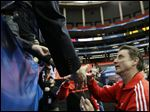 Louisville head coach Rick Pitino greets fans today after practice for their NCAA Final Four tournament college basketball semifinal game against Wichita State in Atlanta.