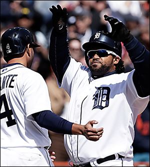 Prince Fielder, right, is congratulated by Omar Infante after hitting a three-run home run against New York Yankees.