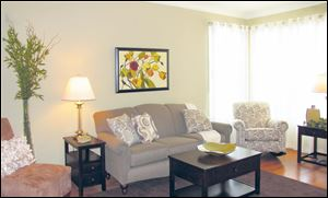 Corner windows make this comfortable living room light and bright.