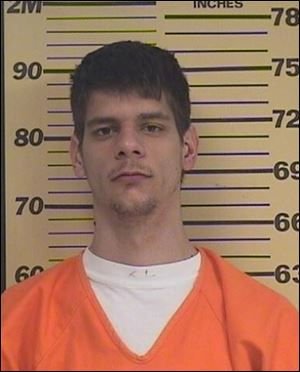 Kyle Kovac is being held in jail on multiple charges after returning with weapons to his former workplace.