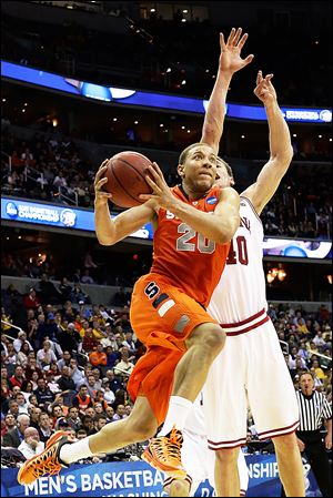 Syracuse guard Brandon Triche shoots past Indiana forward Cody Zeller during a Sweet 16 game on March 28. Triche claimed the Orange have mismatch advantages over Michigan at every position.
