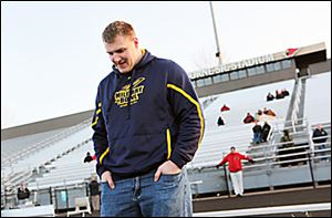 Ben Pike waits to be introduced during UT's scrimmage at Mentor, Pike's alma mater.