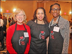 Norma Tomlinson, Shanda Gore and Florence Buchanan pose during the 5th Annual Celebrity Wait Night Fundraiser for the Catharine S. Eberly Center for Women at the Toledo Hilton Garden Inn.