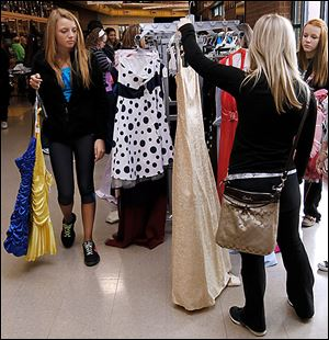 Swanton eighth grader Sarah Yaney, left, shops for a formal dress with her friends during the prom dress sale at Owens Community College in Perrysburg Township.